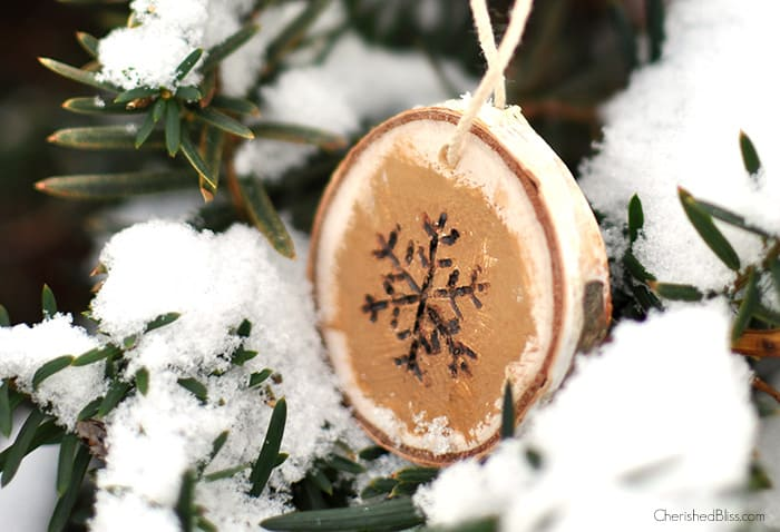 6. Make Some Wood Burned Snowflake Ornaments for Your Christmas Tree