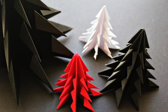 71. Learn How To Make These Cool Origami Christmas Tree Ornaments