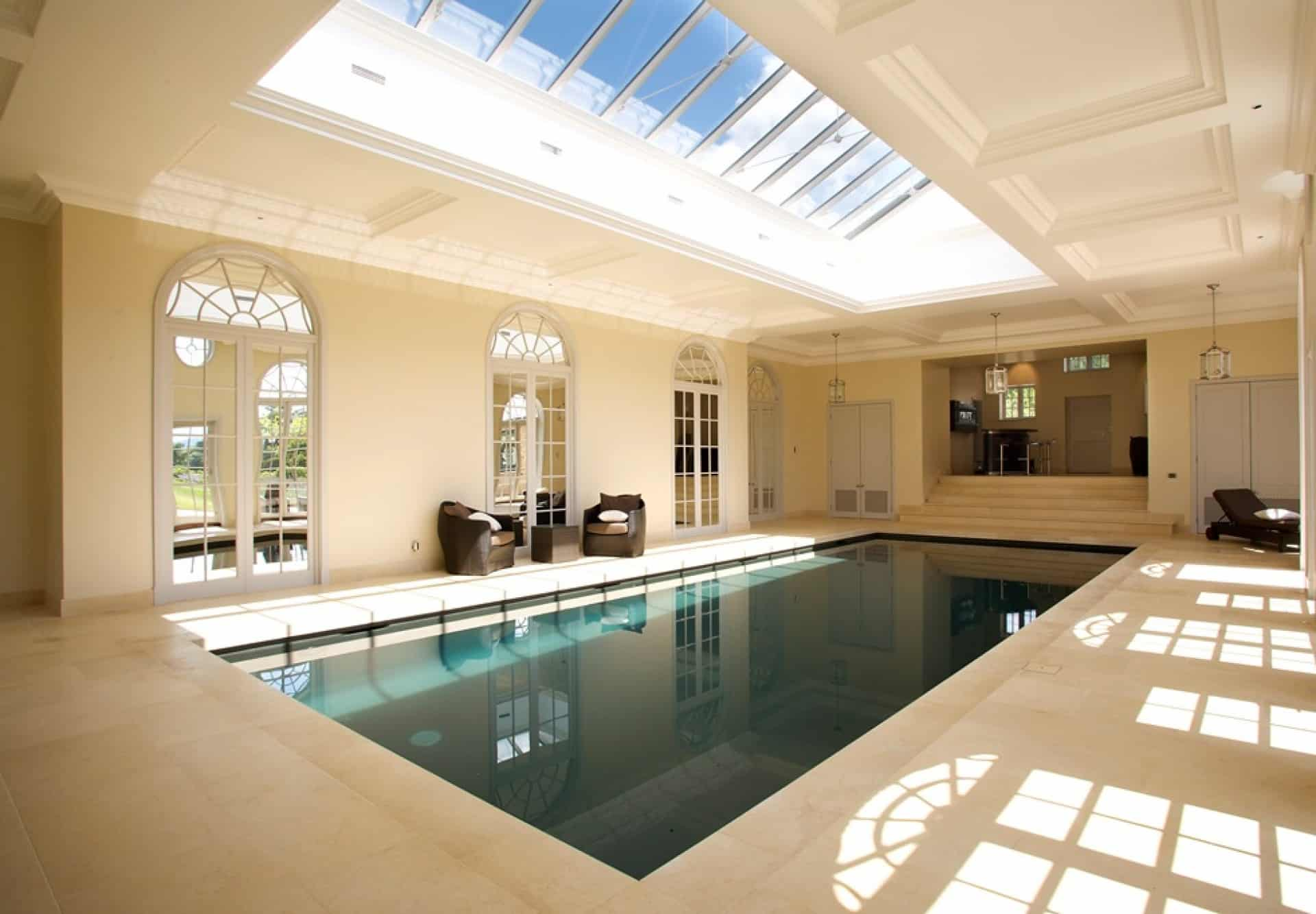 Exciting Transparent Skylight Combined with Cool Indoor Swimming Pool and Comfortable Arm Chairs