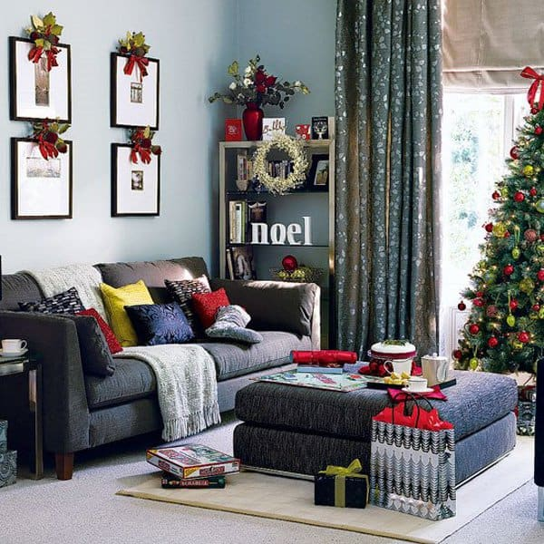 appealing hgtv xmas decor ideas with photos on wall and black sofa also square table