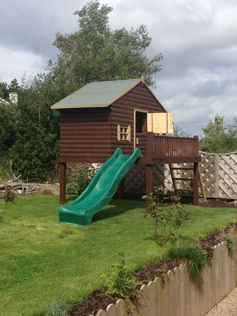 THE PLAYHOUSE WITH A SLIDE