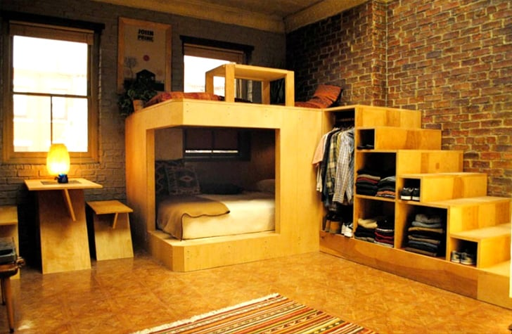 small apartment with cantilevered bed,