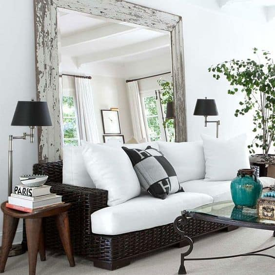 Use Large Mirrors In Your Living Room To Create The Illusion Of Space