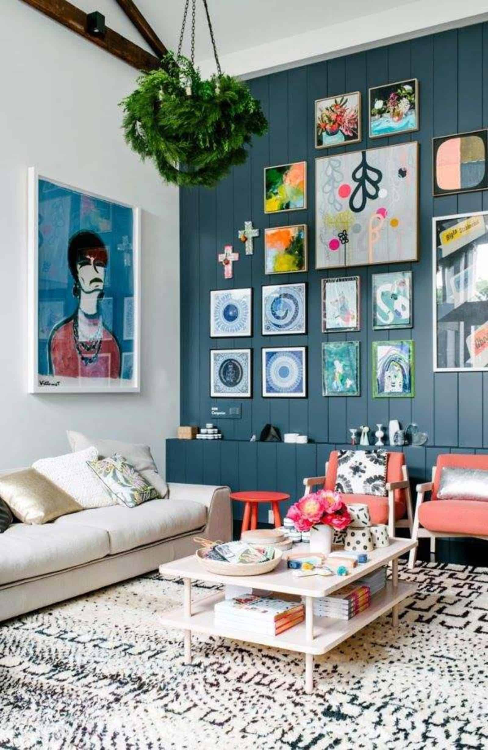 Vintage Gallery Wall With Multi Colored Frames For Small Living Room Design Ideas