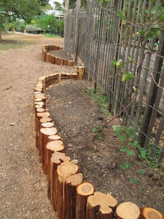 47. Use a Wooden Log Garden Edge