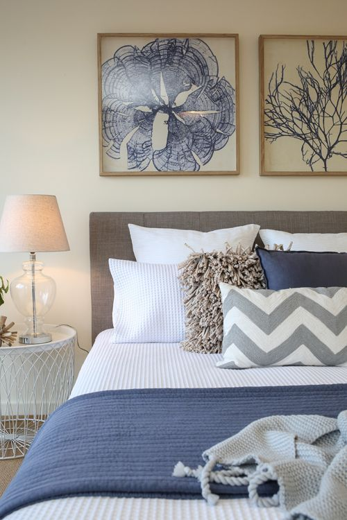 24. Balanced Bedroom With Navy Blue Accents