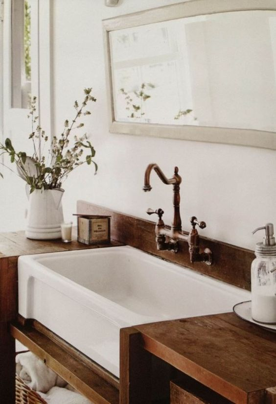 27. White Sink Submerged In Bathroom Wooden Counter