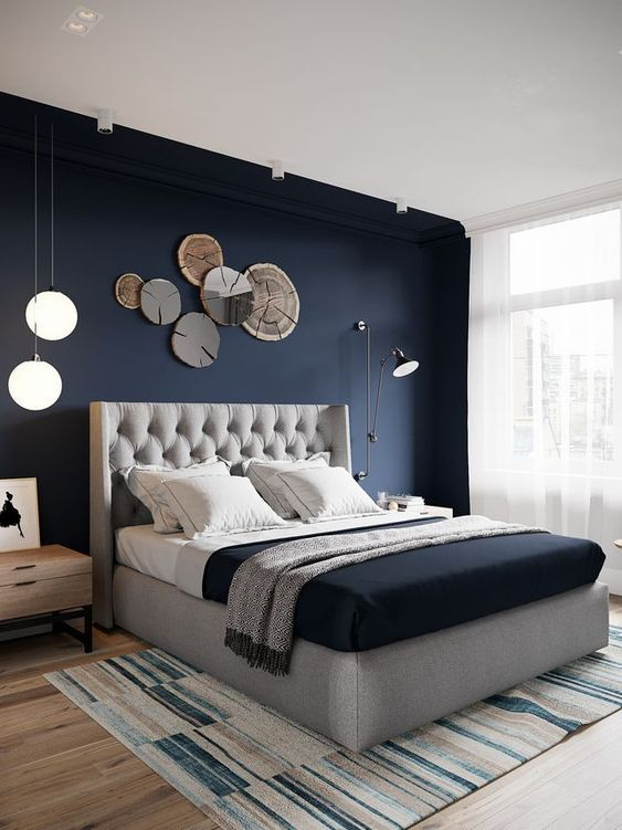 18. Navy Modern Bedroom With Wooden Wall Art