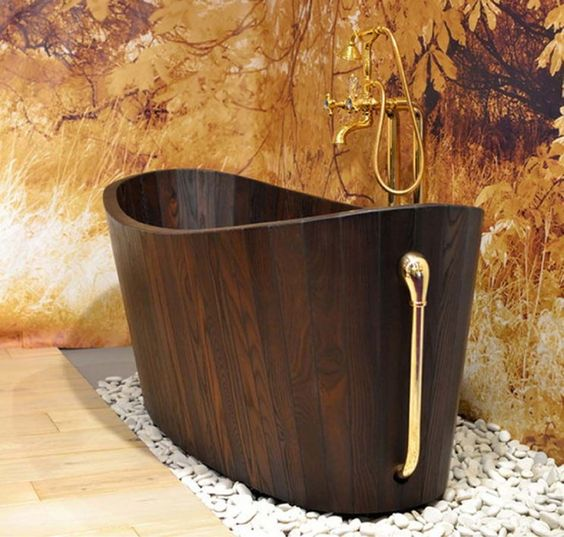 41. Golden Accents Enhance a Wooden Tub