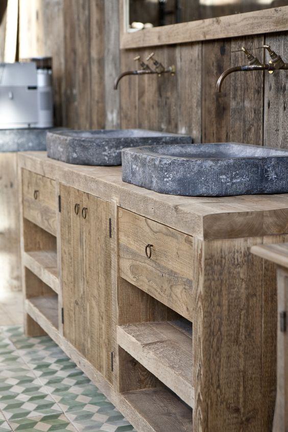 21. Sinks Sculpted in Stone Rest on Wood
