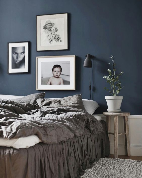 33. Earthy Tones in Blue Bedroom