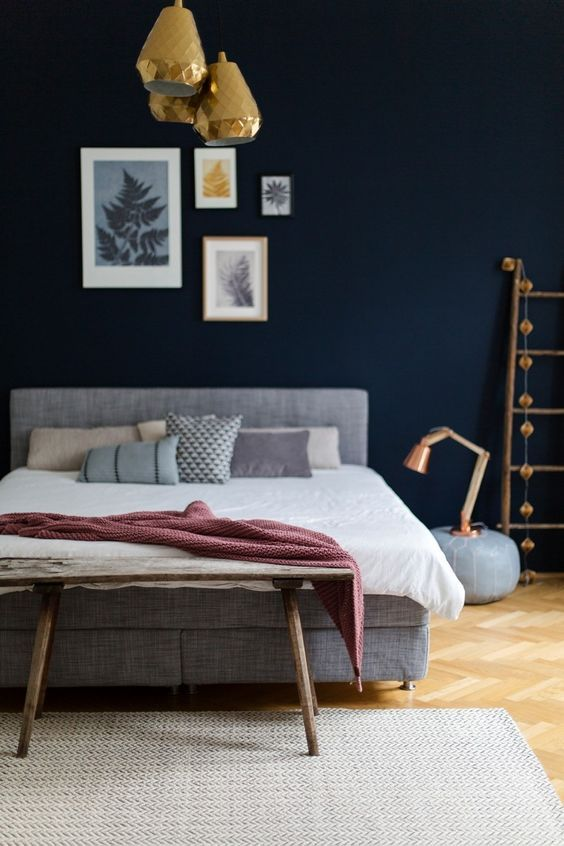 1. Navy Bedroom With Golden and Copper Accents