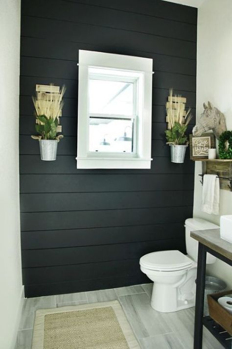 52. Black Wooden Accent Wall Dominates Bathroom