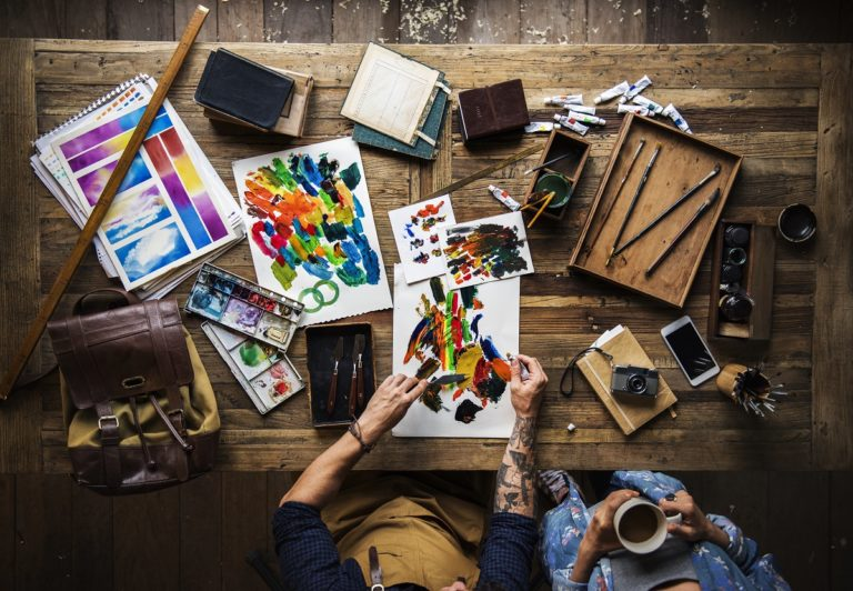 Artist drawing with acrylic paint