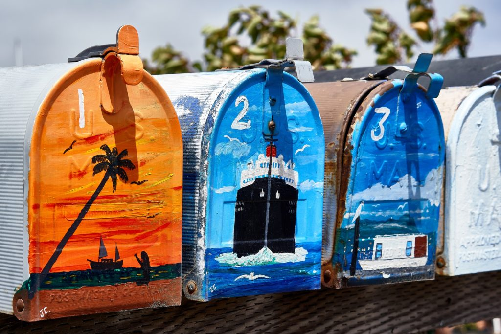 painting with acrylics on metal mailboxes