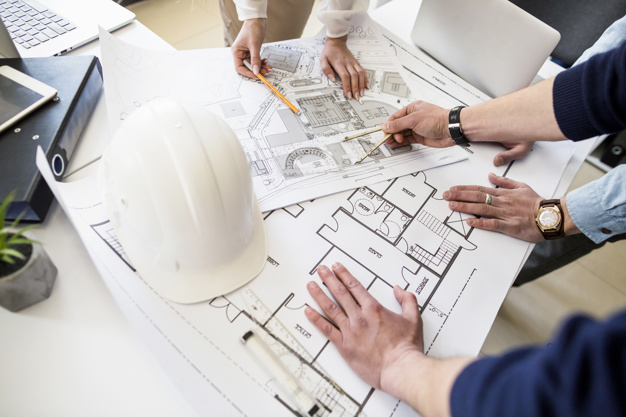architects engineer discussing table with blueprint 23 2147842977