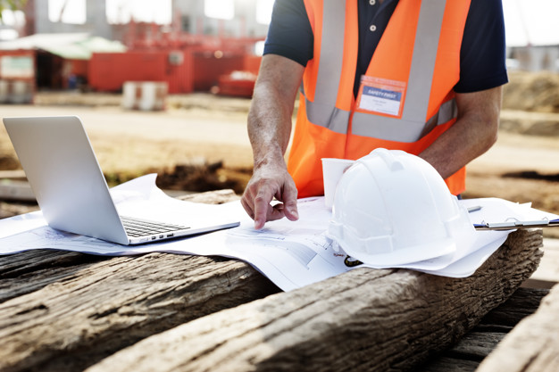 closeup contractor construction site pointing plan wooden sleeper 53876 23070