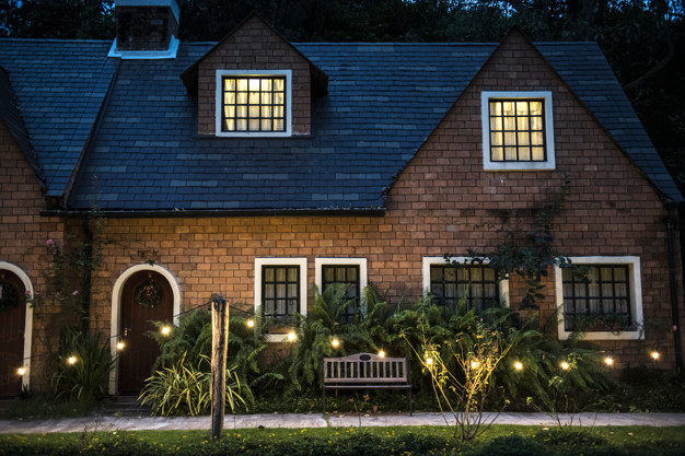 beautiful red brick house with decorative lights 53876 49372
