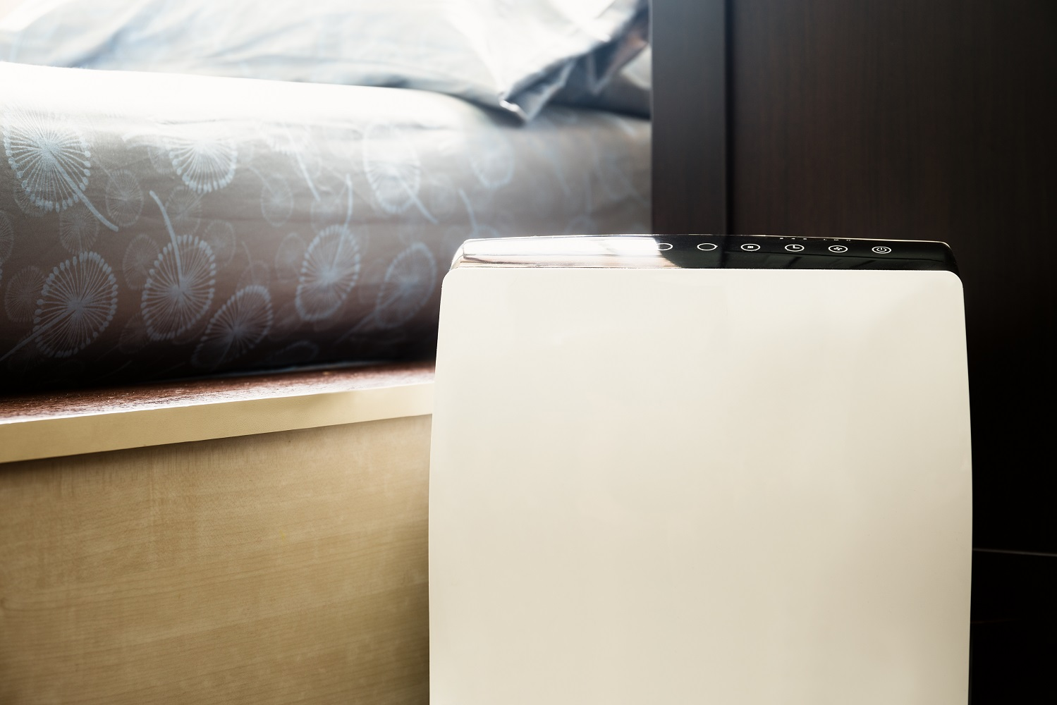 Air purifier in the bed room cleaner removing fine dust in house