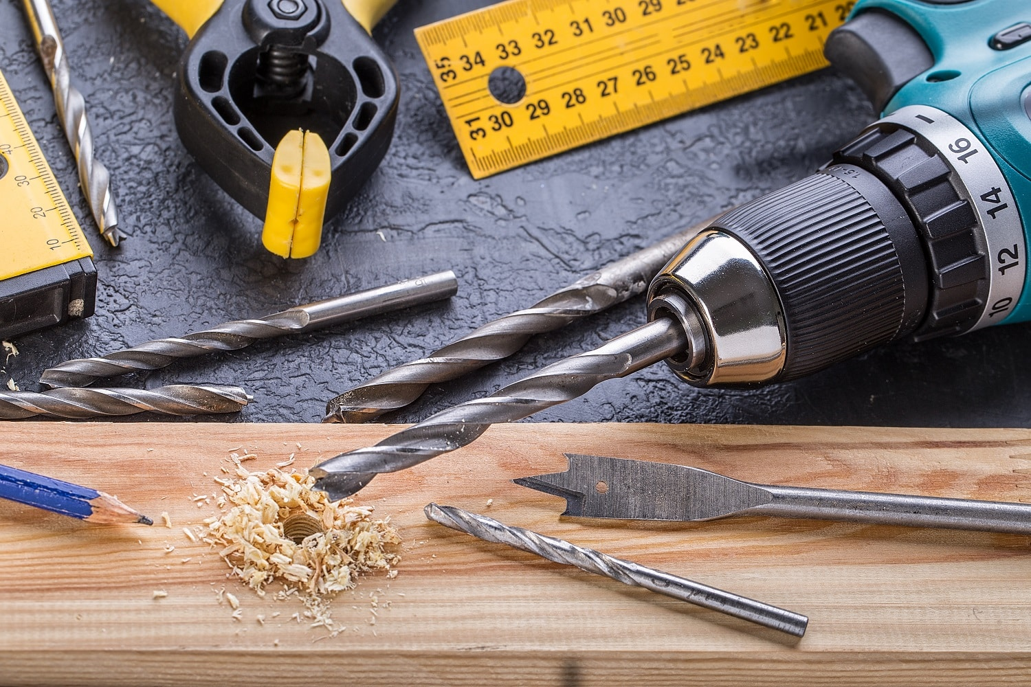 Working Tool on a Wooden Background. Set of carpenter's tools on wooden table
