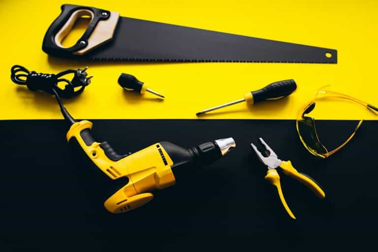 Set of yellow tools on a black and yellow background