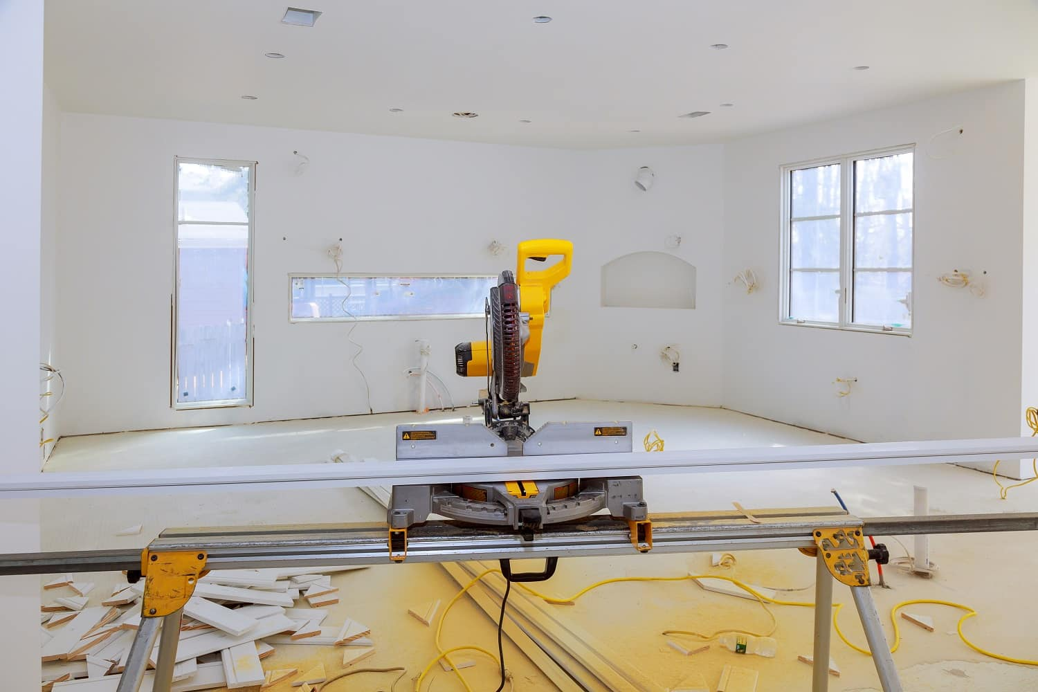 Contractor uses a circular saw to cut trim molding saw on a construction site
