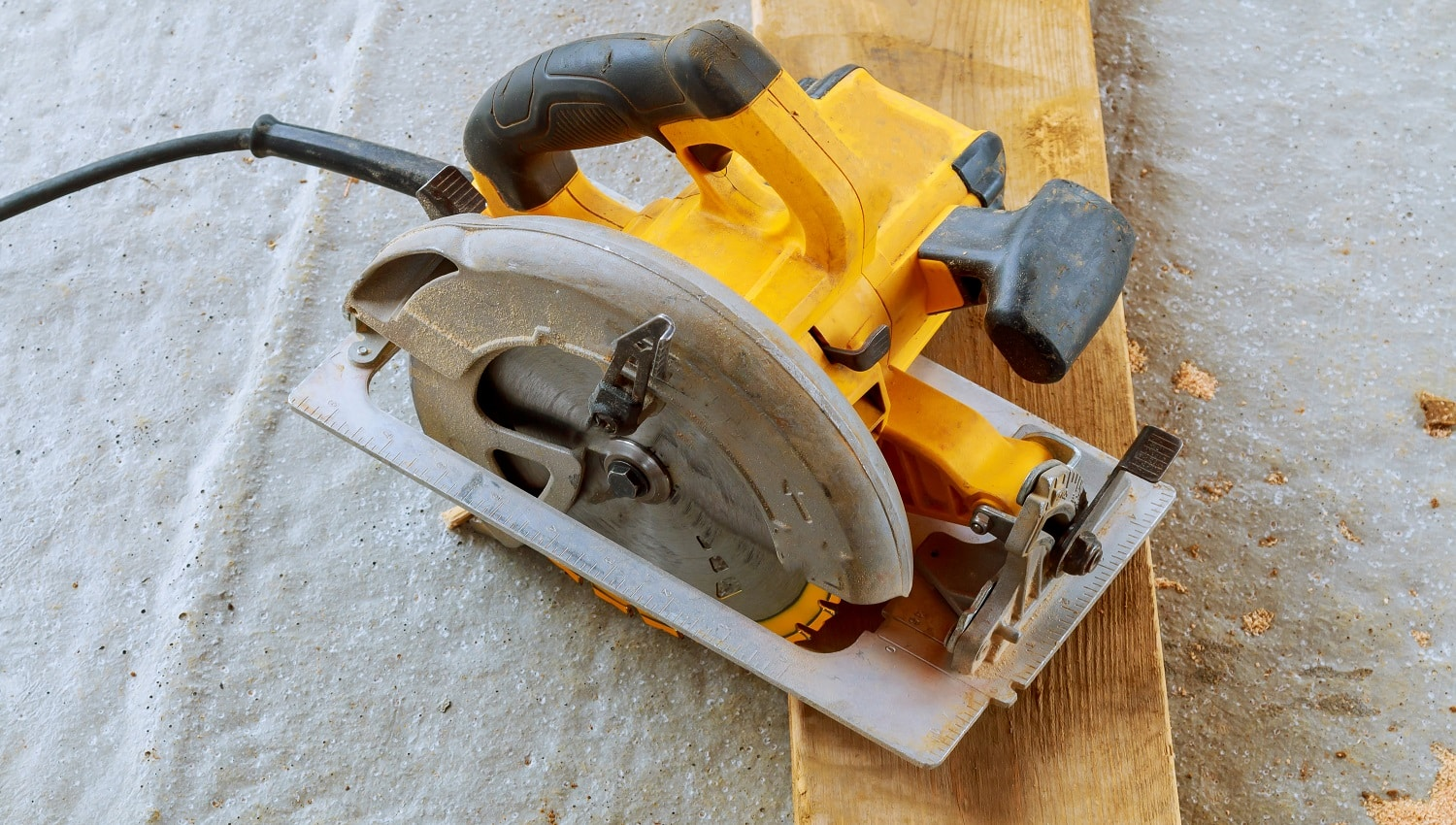 Close up electric circular saw cutting wood Wood cutting with circular saw