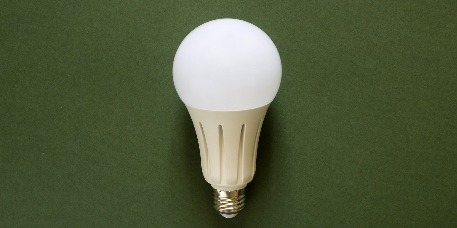 New powerful energy-saving, LED light bulb on a green background