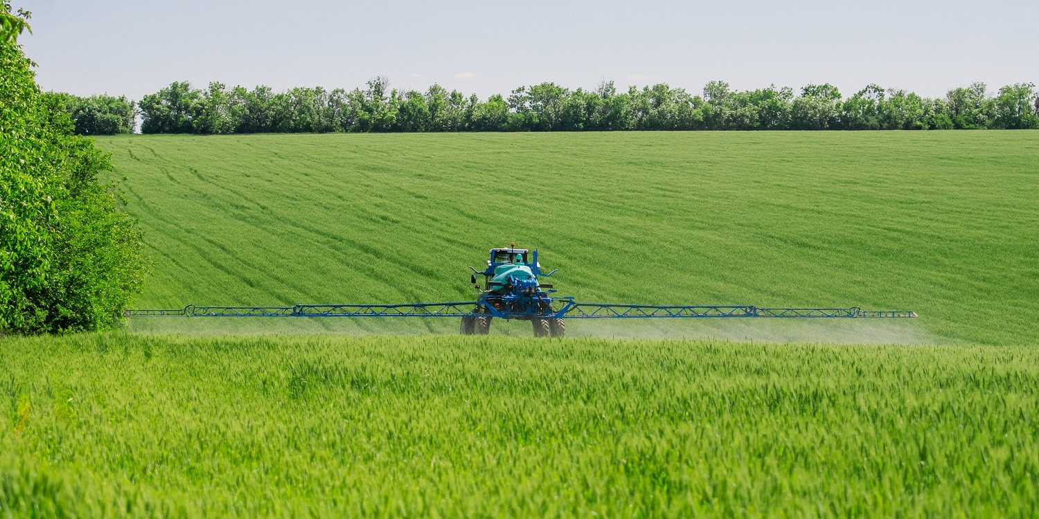 Agricultural sprayers, spray chemicals on young wheat. spraying pesticides on wheat field with sprayer