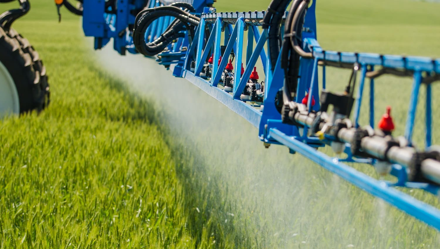 Agricultural sprayers, spray chemicals on young wheat spraying pesticides on wheat field with sprayer
