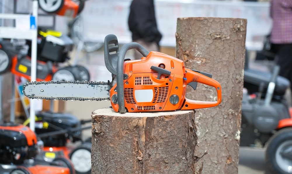 chain saw on log at market outdoor