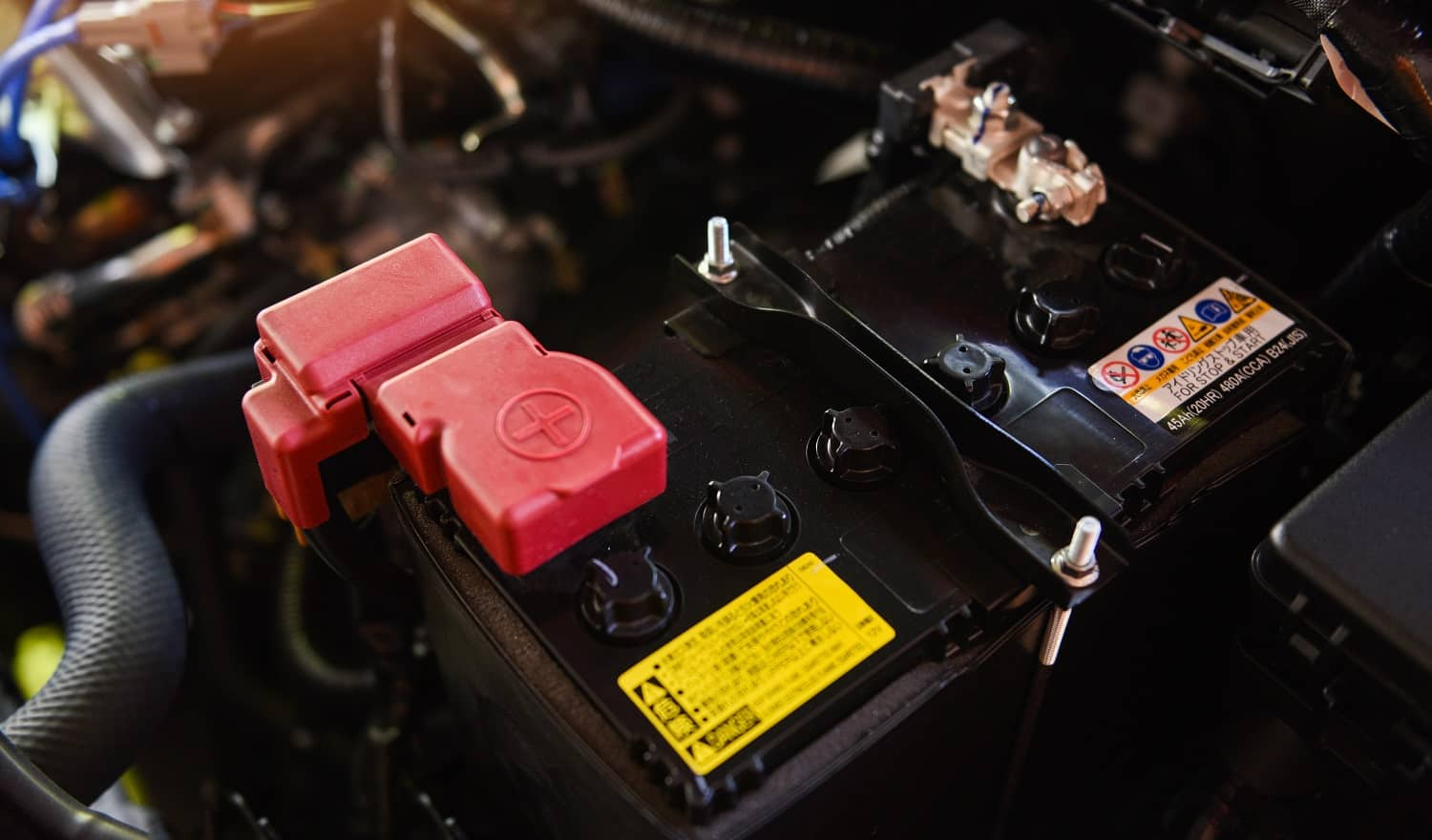 closeup new battery car in engine room / mechanic car battery