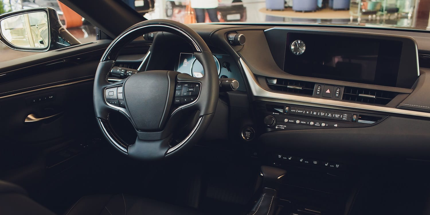 car interior. Modern car speedometer and illuminated dashboard. Luxurious car instrument cluster. Close up shot of car instrument panel