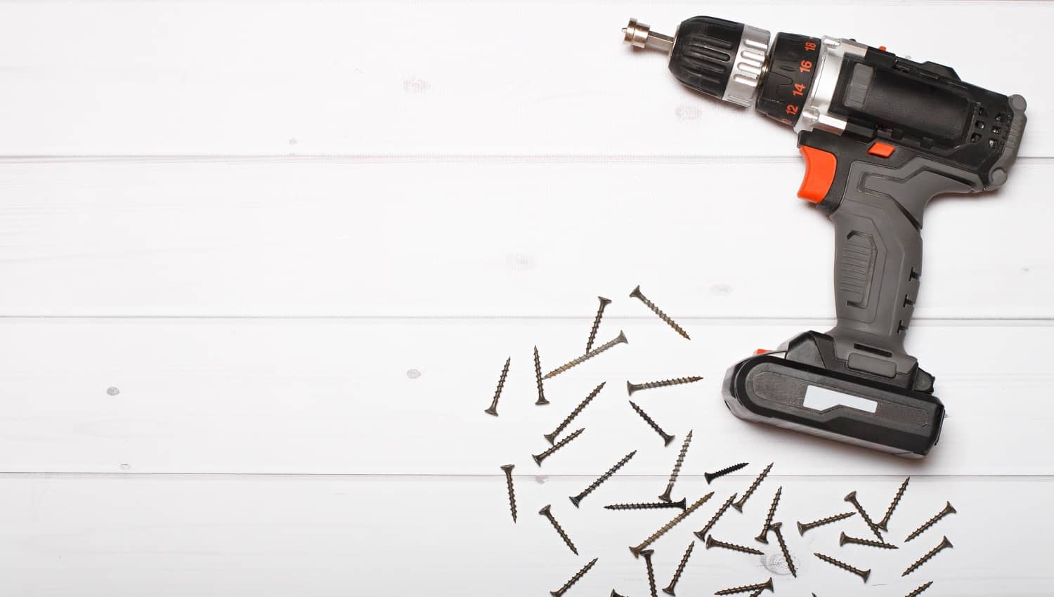 Compact cordless screwdriver isolated on a white background