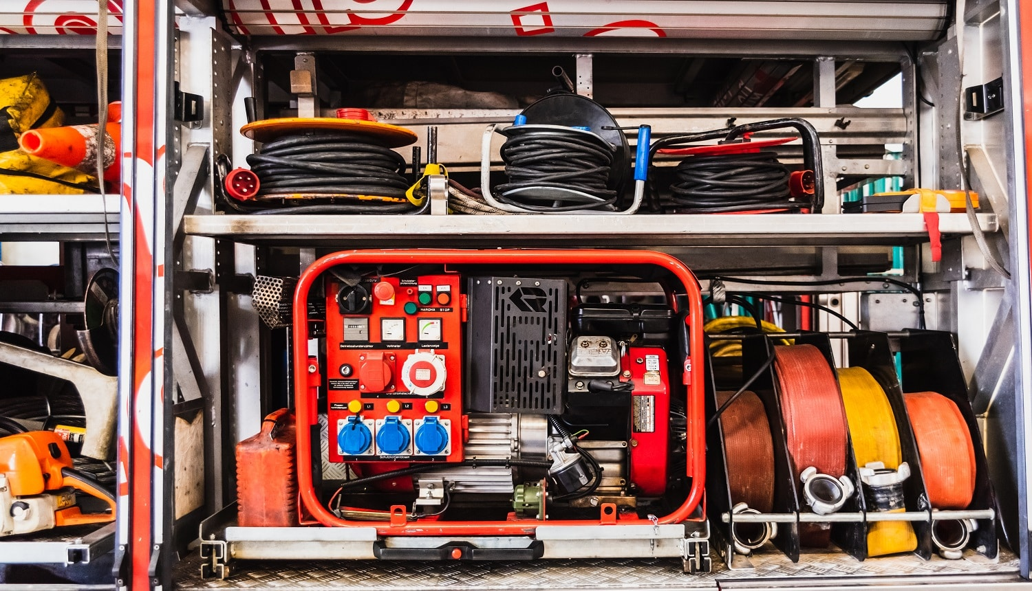 Emergency material of a fire truck, with generator set and hoses.