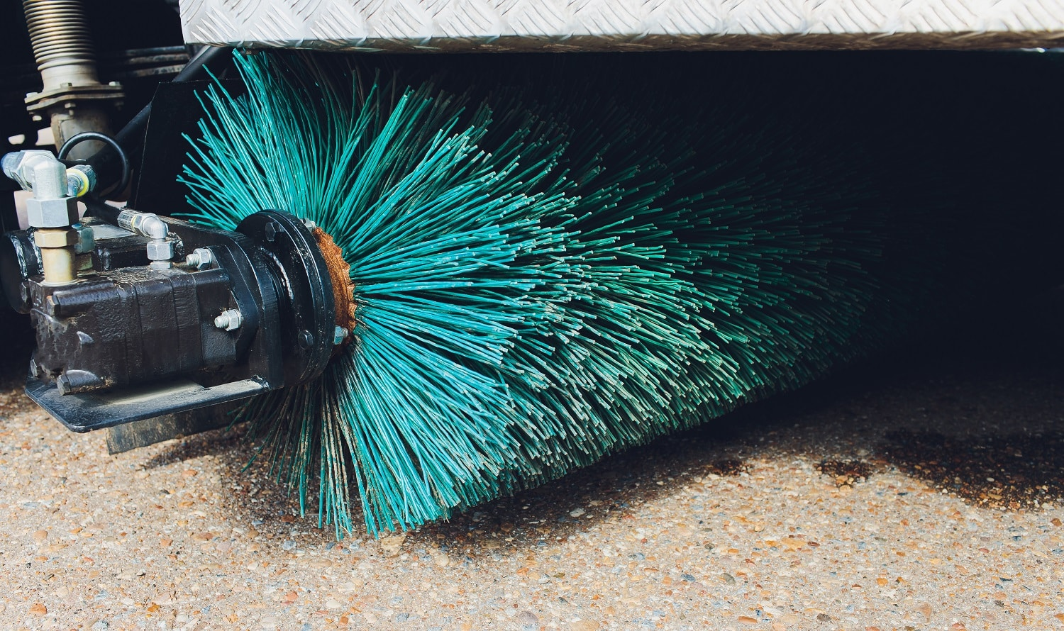 Close up shot of a road brush sweeping machine