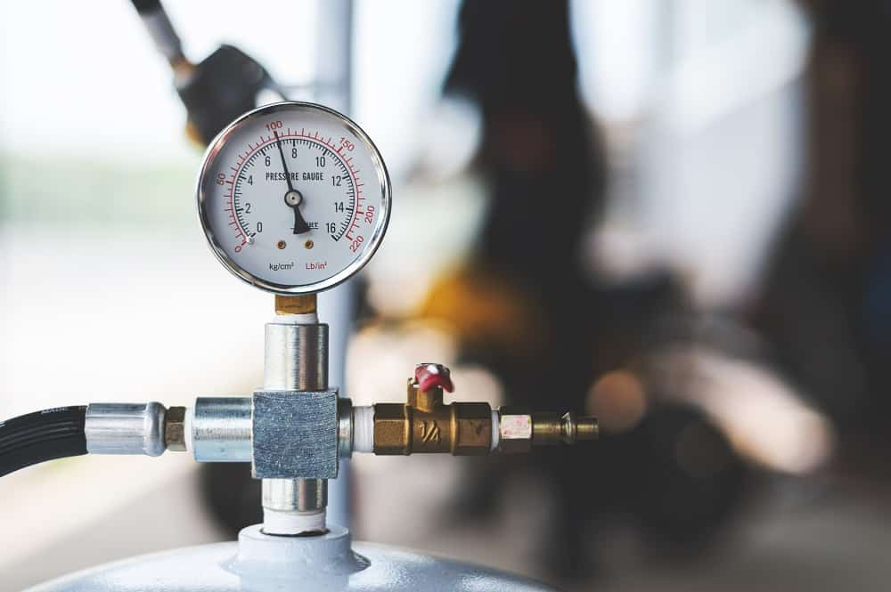 pressure meter of air compressor with soft-focus and over light in the background