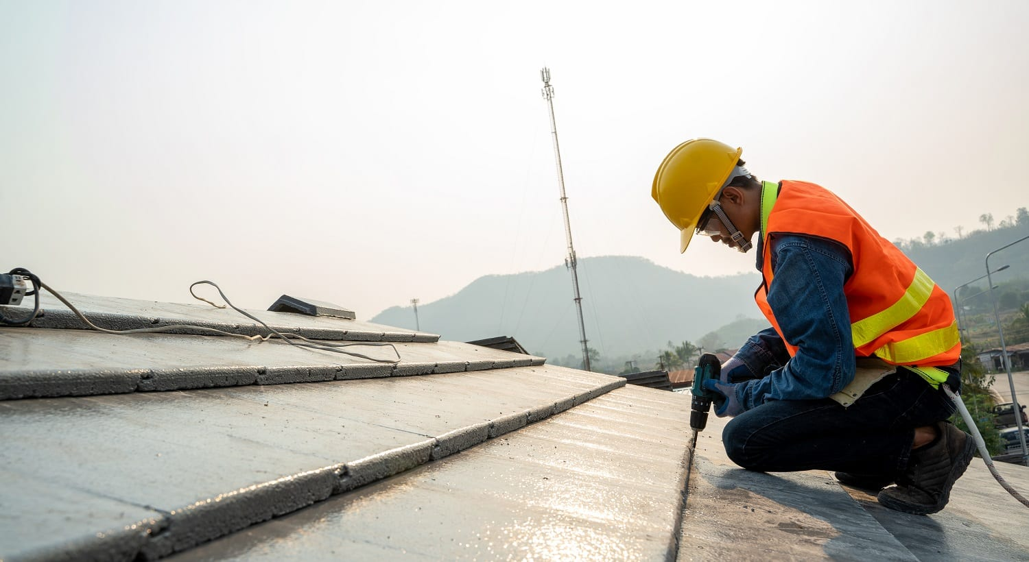 Construction engineer wear safety uniform inspection roofer working on roof structure of building on construction site.