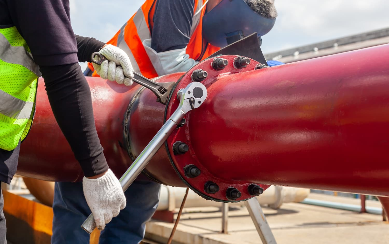 Worker install Tightening bolts & Nuts of piping Flange system. In the industrial plant.