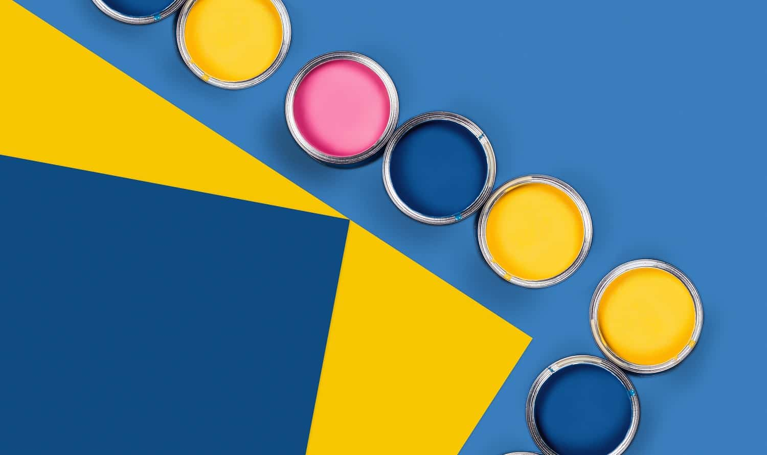 Renovation concept. Blue and yellow background with group of colored paint cans. Flat lay, top view, copy space.