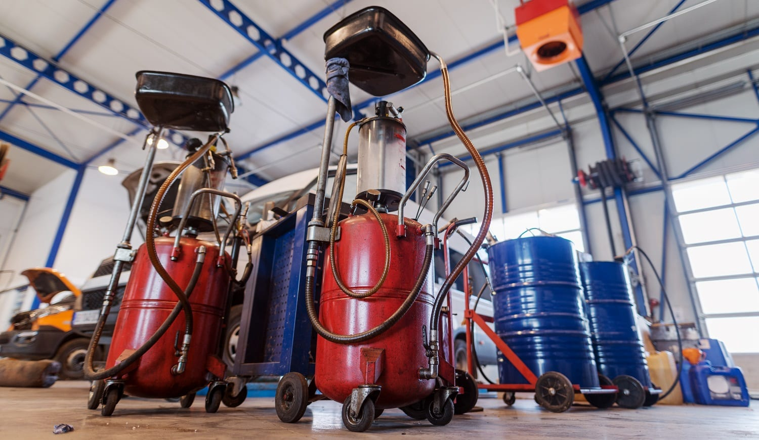Picture of tanks with motor oil or gasoline in car workshop.