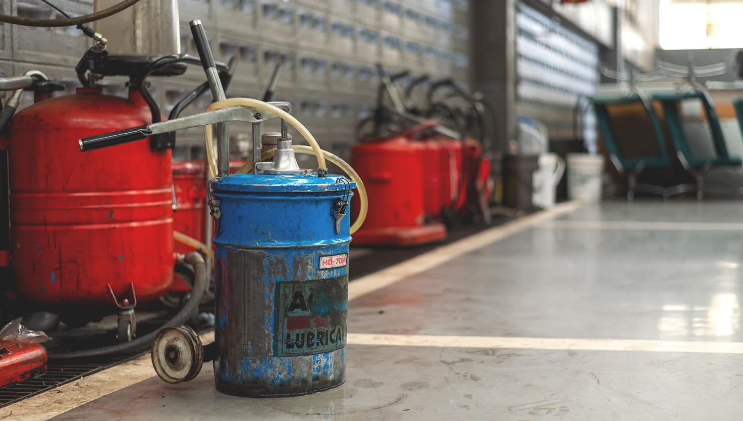lubricating oils tank in the garage with soft-focus and over light in the background