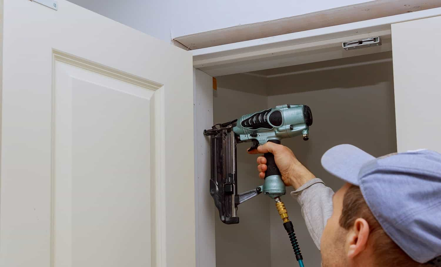 Installation of interior room doors using a air nail pneumatic gun