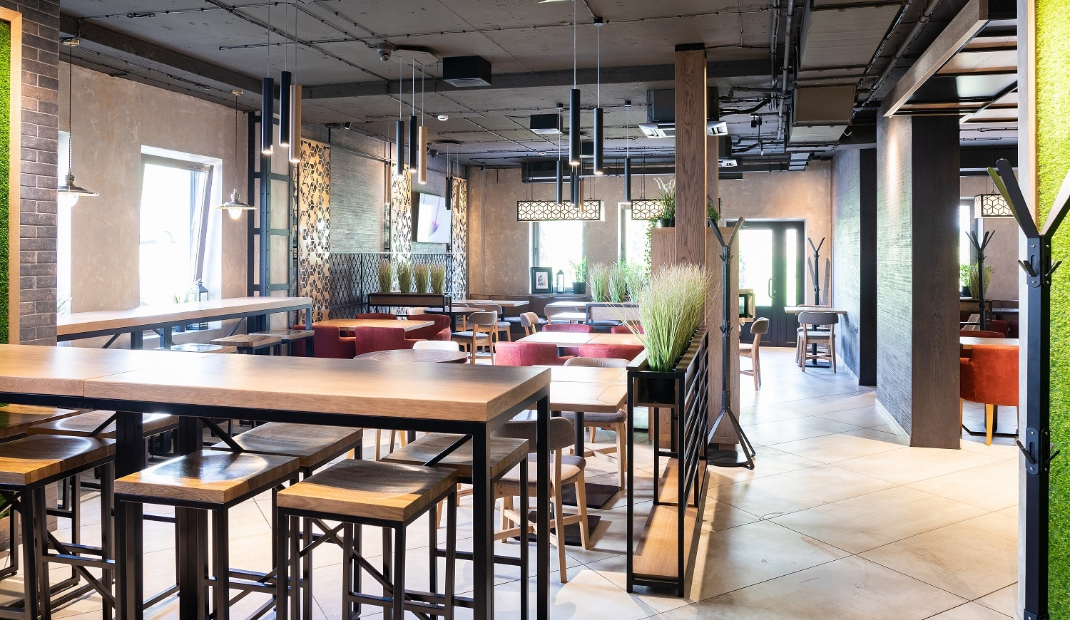 Main hall in the new modern restaurant in freshh green style with exquisite modern furniture