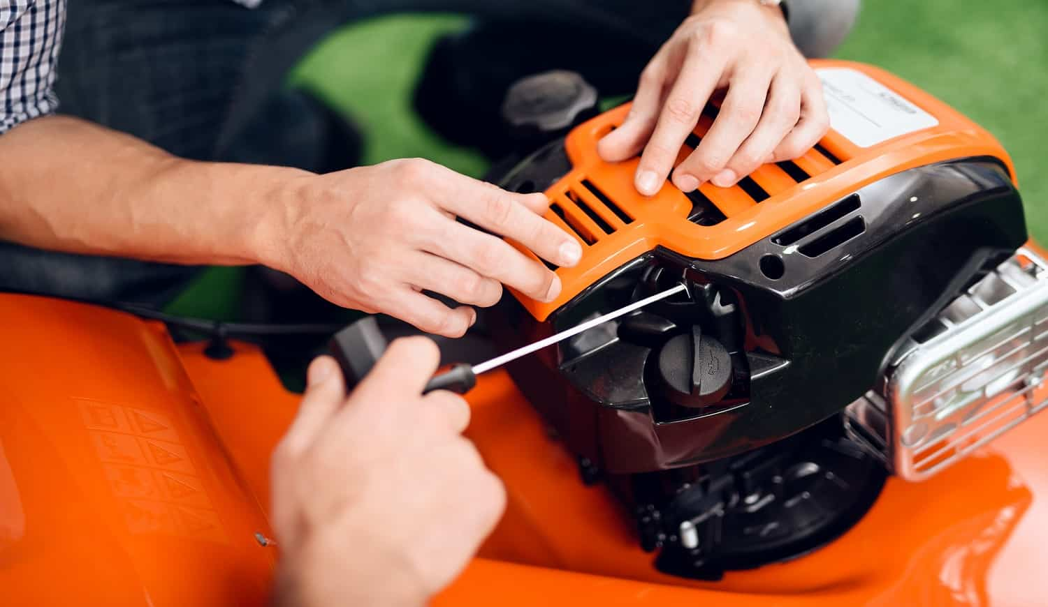 A man starts a lawnmower motor in the store.