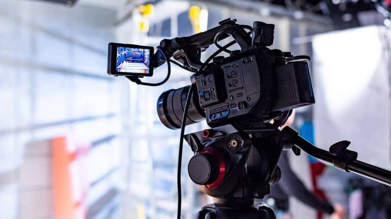 Behind the scenes of video production or video shooting at studio location with film crew camera team.