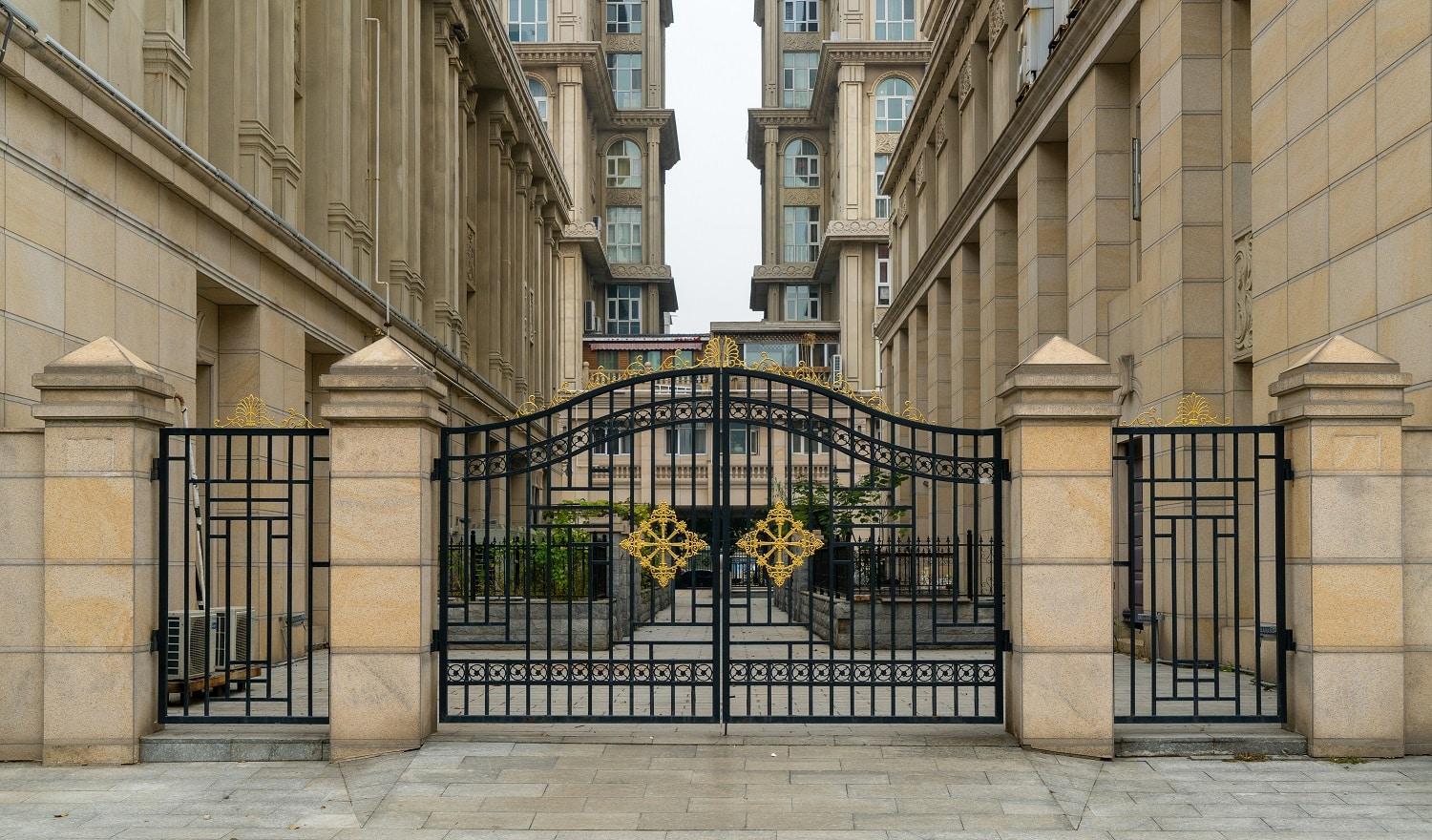 Iron gate at the entrance of residential building in residential area