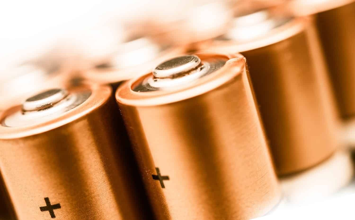 AA Batteries Closeup on a White Background. Batteries Technology. Power Industry.