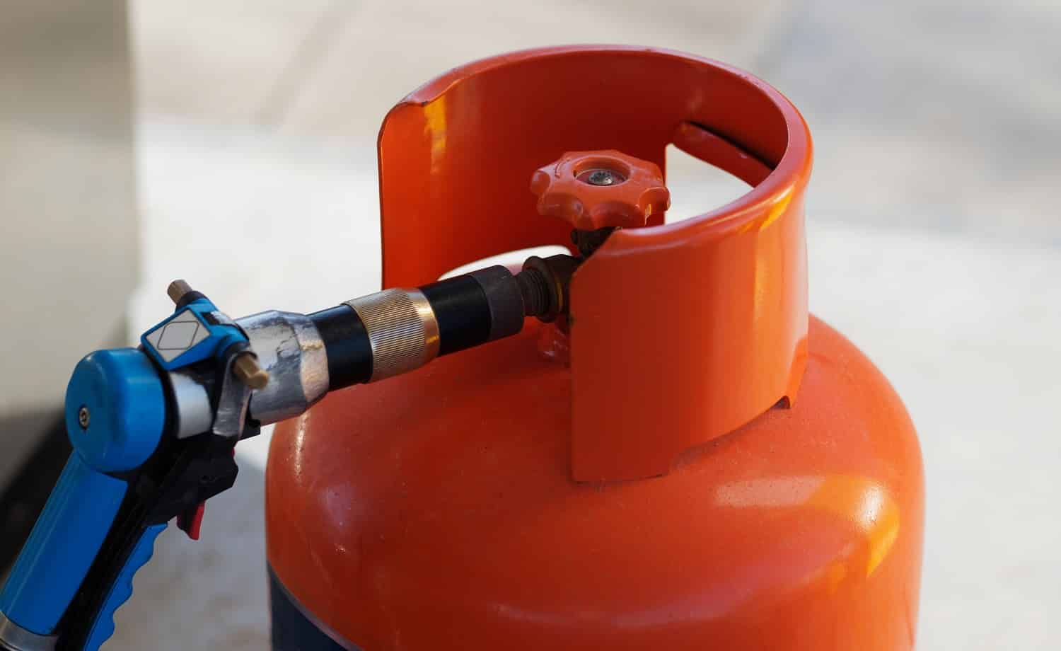 Close-up view. Refilling Gas Cylinder at a gas station. Dominican Republic.