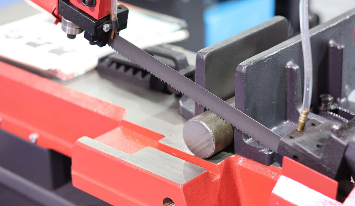 Steel bar cutting by band saw machine with coolant